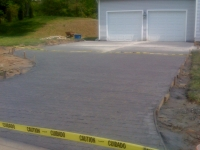 decorative-concrete-stamped-concrete-overlays-cobblestone-pattern-driveway-2